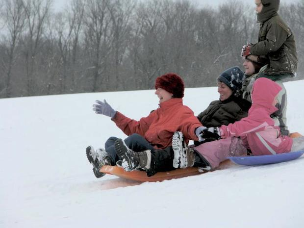 Connecting with family and friends through activities like sledding can provide more long term satisfaction than buying and giving gifts