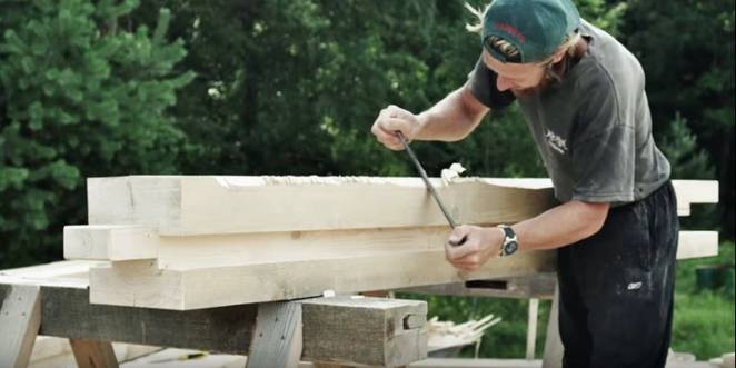 Watch these craftsmen build a home from wood with traditional tools